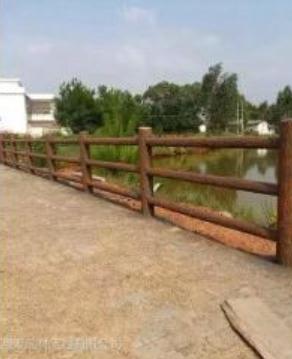 郑州天艺厂家直销新乡地区批发仿树皮栏杆配合水景水泥产品